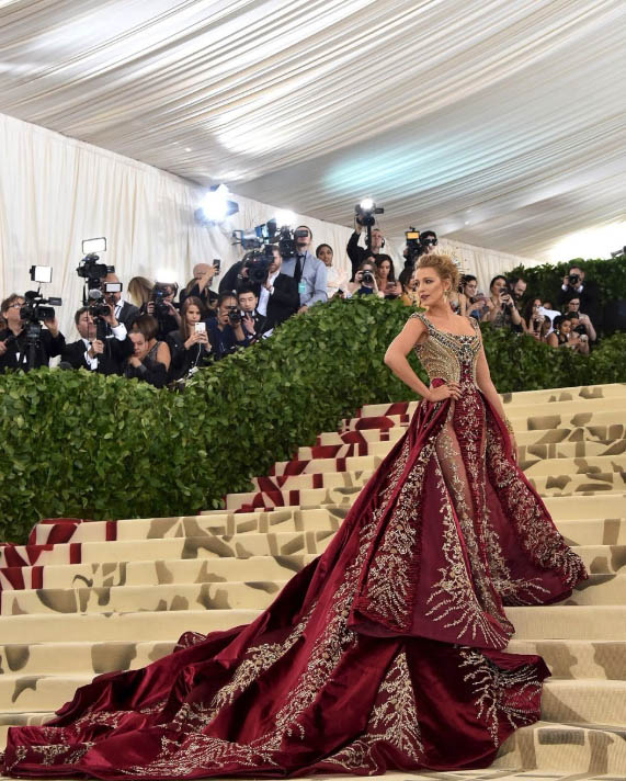 ce071d024171 Blake Lively pulled a true Serena Van Der Woodsen donning double Versace in  a pre-gala robe followed by an elaborately regal creation that took over  600 ...