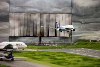Planes fly in from one wall, land, and taxi to the gate...