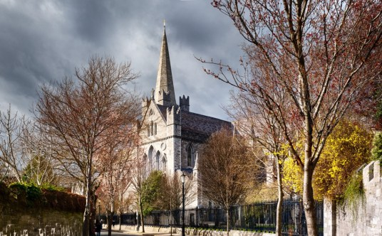 A view of St. Patrick's Cathedral, with budding trees in the foreground.