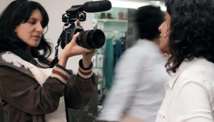 Laura Salas filming at a V4C convening in Mexico City.