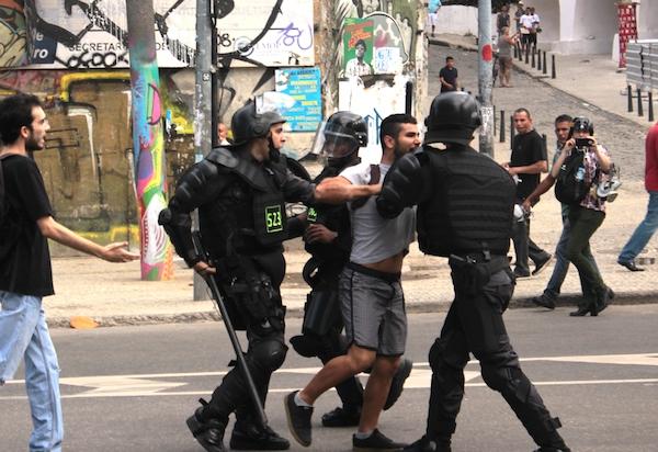 A protester is arrested in Rio de Janeiro, June 12, 2014. (c) Camila Nobrega