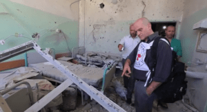 Video still from the International Committee of the Red Cross shows aid workers surveying conditions at the Al Aqsa hospital in Gaza following repeated attacks in the area.