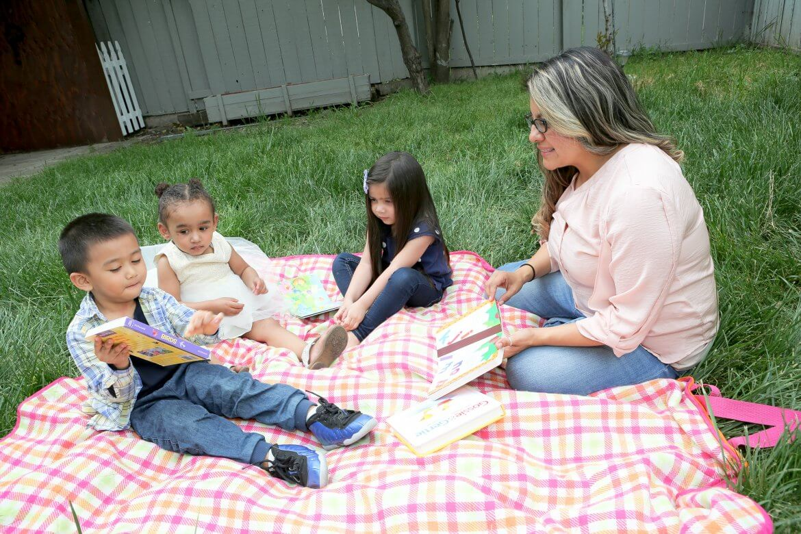 Sitting outside with children from home child care