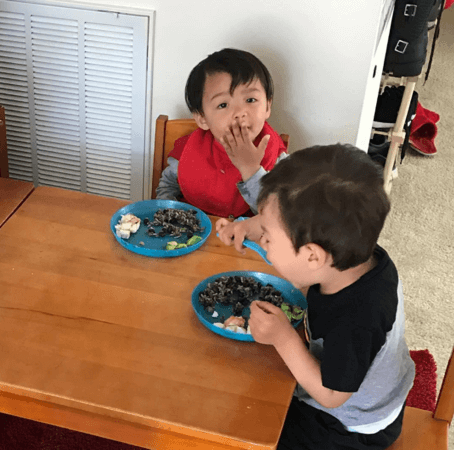 Carlo eating in mixed age home preschool