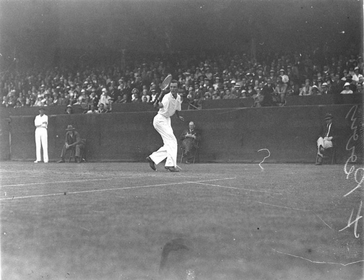 SLNSW_7817_English_ace_Fred_Perry_in_action_centre_court_White_City