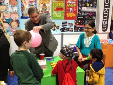 Sean Connolly demonstrates some of the more surprising principles of sound waves to some young science buffs.