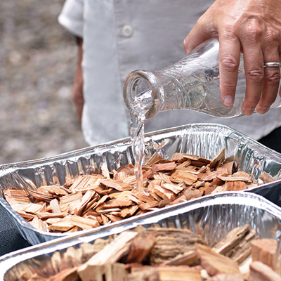 Soak the wood chips in water to cover prior to smoking.