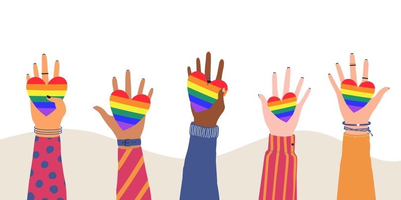 Vector illustration of cartoon flat Hands Holding Hearts with rainbow colors. LGBTQ symbol of Love, Freedom, Peace, Lesbian. Gay Pride Community Month