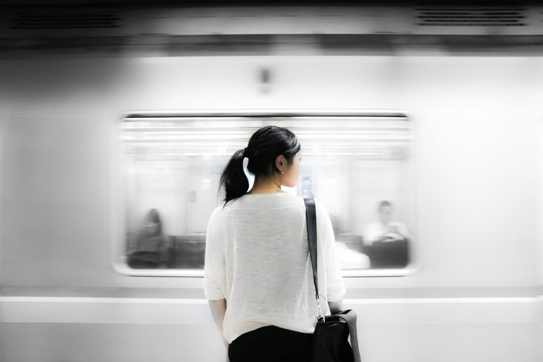 Woman standing in front of subway - career coaching