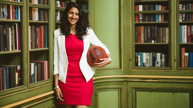 Yasmine Helal with a basketball in a library