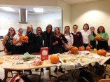 International Exchange Team and Ms McDonald carving pumpkins (October 2017).