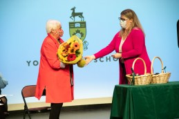 Courtney (Smith) Cousineau '99, President of the YHS Alumnae Association, presented Stevie (Bryson) Mitchell '61, with a beautiful bouquet of flowers to acknowledge her selection as this year's Alumnae Lifetime Achiever.
