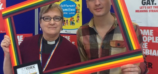 #byyourside Rev Anne Rowley and Andy Law - holidng rainbow frame