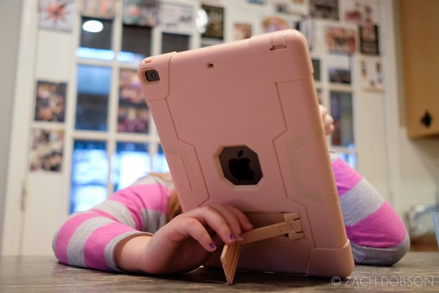 kid using ipad in pink case