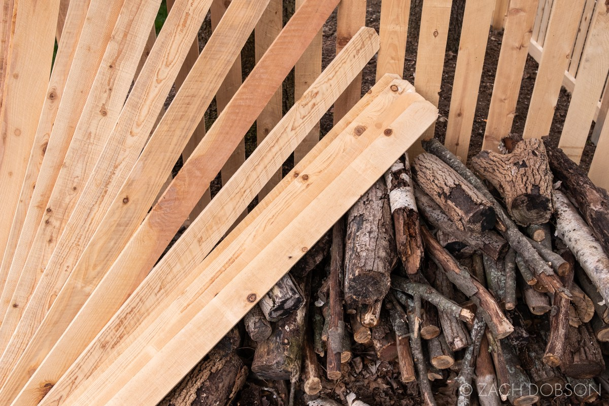 building a fence and pile of firewood