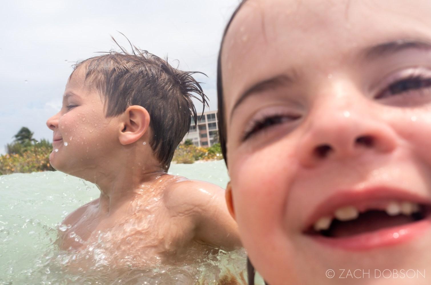 kids swimming in ocean
