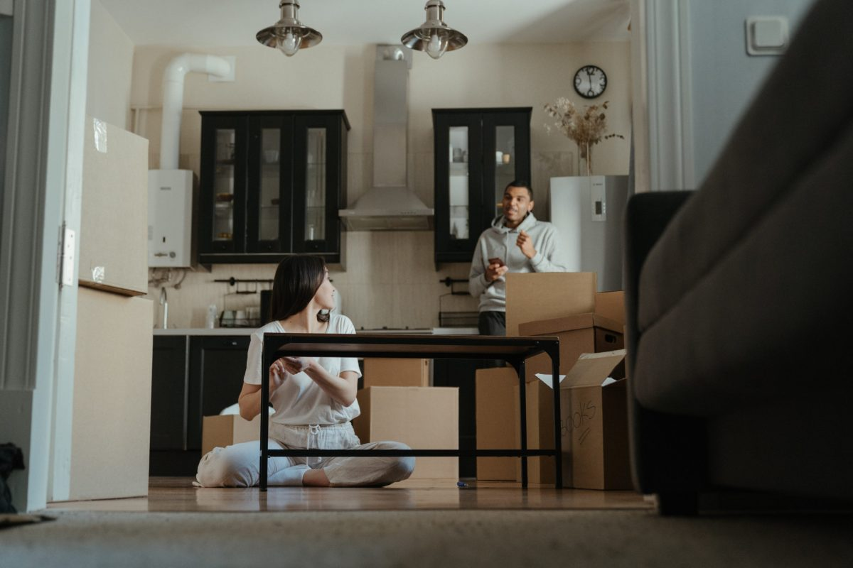 couple in the living room opening boxes