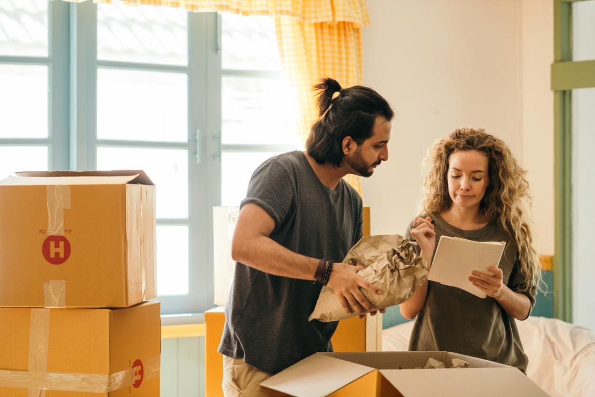 A couple discussing questions to ask before moving into new house