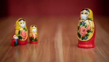 Russian dolls social distancing at home due to COVID symptoms