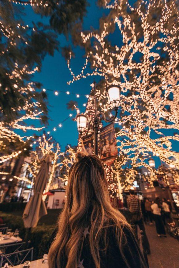 A girl admiring Christmas decorations