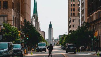 Person crossing the road in Tulsa city
