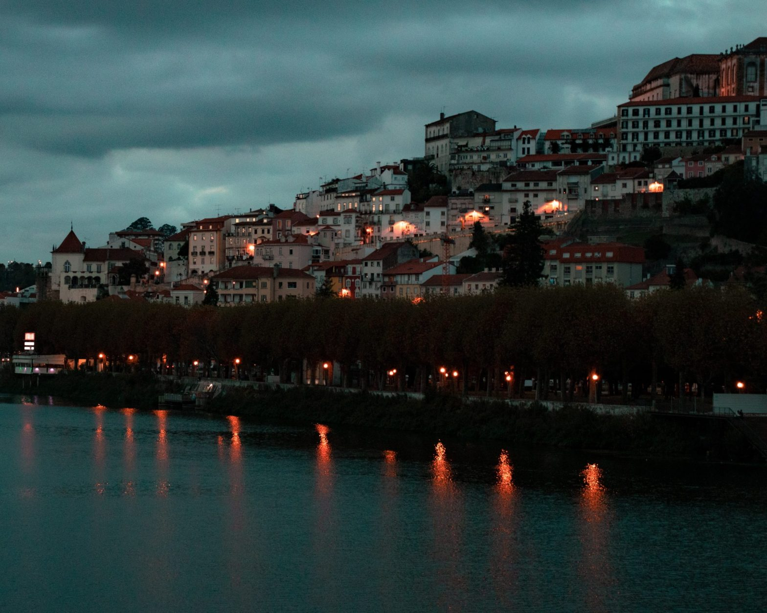 Seaside of Coimbra at night with lights on