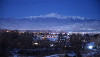Colorado Springs at night with mountain background