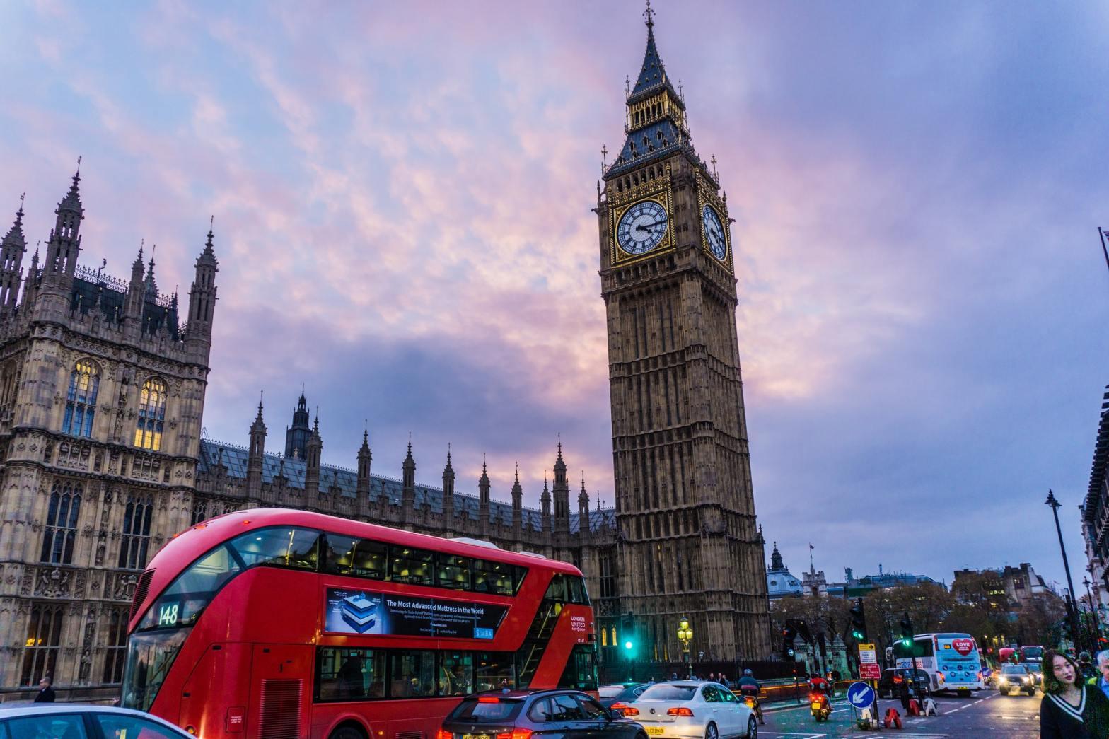 Bus crossing the Big Ben in London