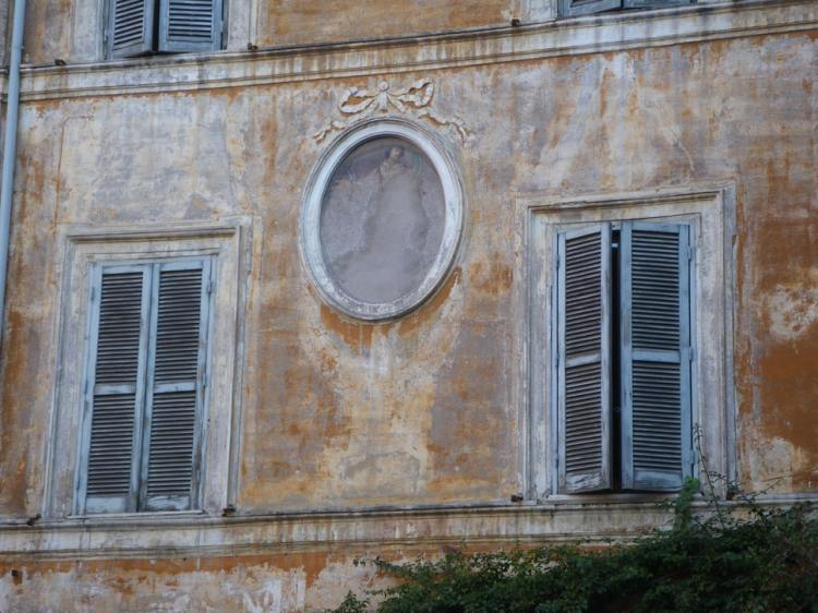 faded painting on a wall in Rome