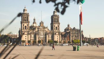 People walking across a town square in Mexico city