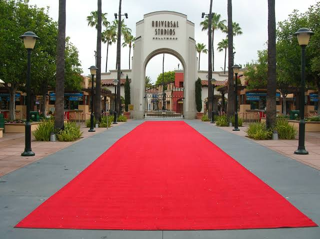 universal studios entrance with red carpet