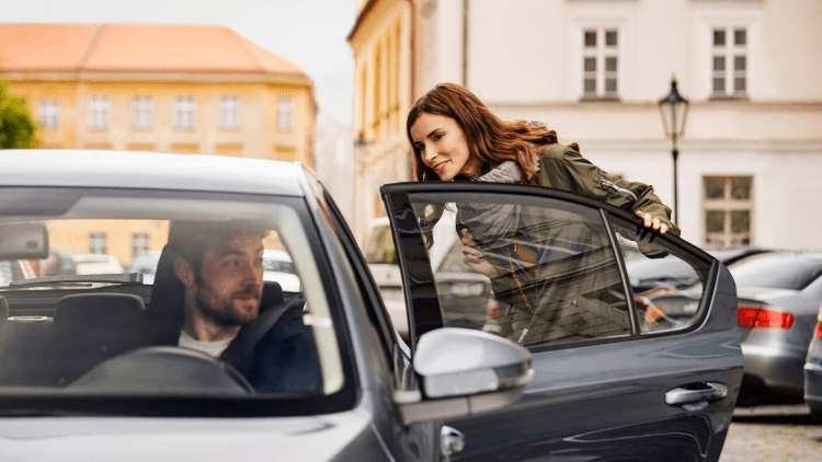 woman getting in car-Uber vs lyft