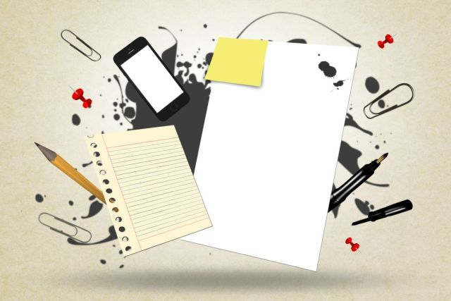 A drawing showing a piece of paper, a pencil and several other items to go with our post about writing tips.