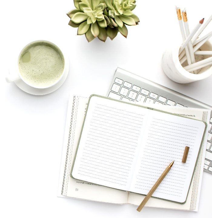 notebook with a green tea latte