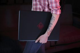 Gamer carrying her Omen by HP Notebook