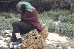 sentada-piedra