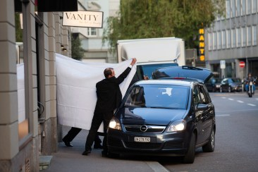 FIFA officials are escorted out behind sheets following their arrests by Swiss authorities at the Baur au Lac hotel in Zurich on Wednesday, May 27, 2015. Swiss authorities said they had opened criminal cases related to the bids for the 2018 and 2022 Word Cups after making the arrests during a raid at the annual meeting of soccerÕs governing body. The U.S. has filed federal charges alleging corruption over two decades. (Pascal Mora/The New York Times)