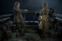 """PIRATES OF THE CARIBBEAN: DEAD MEN TELL NO TALES""..The villainous Captain Salazar (Javier Bardem) pursues Jack Sparrow (Johnny Depp) as he searches for the trident used by Poseidon..Pictured L-R: Brenton Thwaites (Henry) and Johnny Depp (Captain Jack Sparrow)..Ph: Peter Mountain..© Disney Enterprises, Inc. All Rights Reserved."