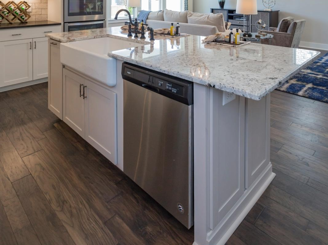 kitchen island with sink and dishwasher