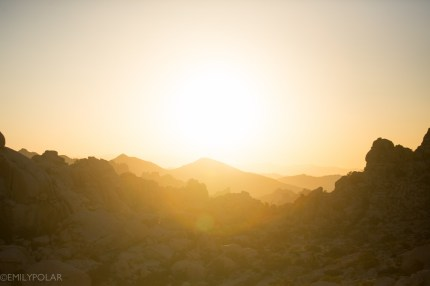 Sun set glowing over rock features at Joshua Tree National Park.
