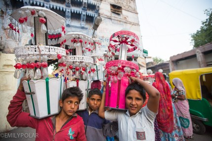 Cute Indian boys in Jodhpur carrying celebration lanterns for ceremony.