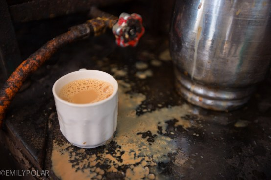 Cute white cup filled with chai tea in the streets of Jodhpur, India.