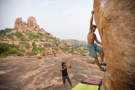 Indian men bouldering at the plateau in beautiful Hampi, India.