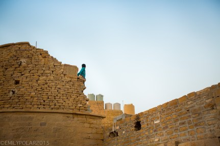 Young boy sitting on the interior walls of the fort in Jaisalmer.