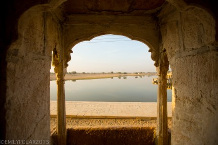 View out to Sagar lake from inside temple with arching windows and pillars in the Golden City of Jaisalmer.