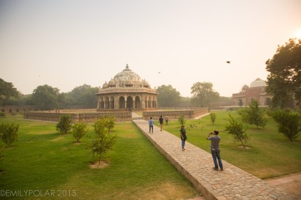 Tourists taking a picture on the beautiful grounds at Humayuns Tomb in Delhi, India.
