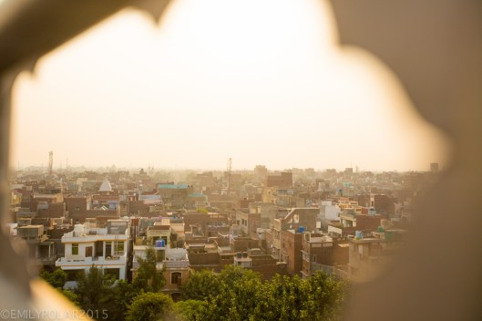 View of Amritsar at dusk in the haze of low light the buidlings and homes sandwiched together.
