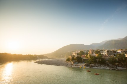 Red rafts float down the Ganges past the north side of Laxman Jhula bridge in Rishikesh, India.
