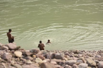 Indian boys swimming in the Ganges river outside of Rishikesh.