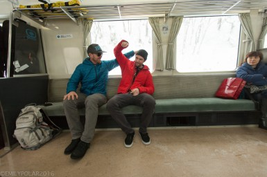 Boys messing around on the train to Niseko, Japan.